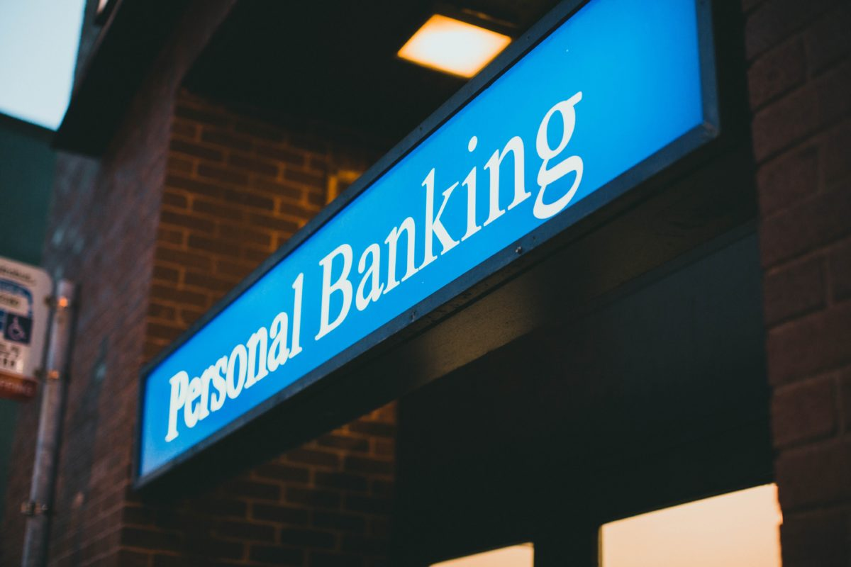 """A blue sign that says """"Personal Banking"""" in white letters."""
